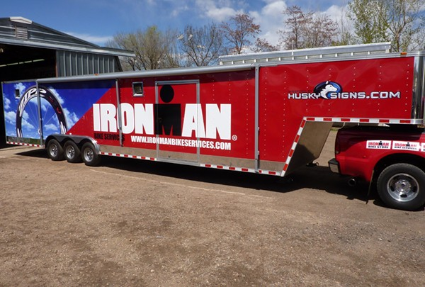 ironman trailer partial wrap - Commercial Signs in Valmont Rd.